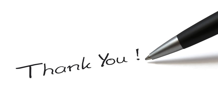 "the words ""thank you"" written by a pen"