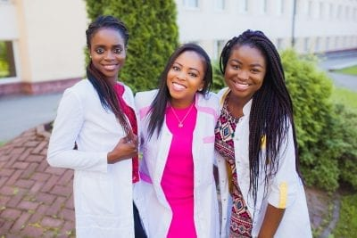 three young african american women recently graduated RN's