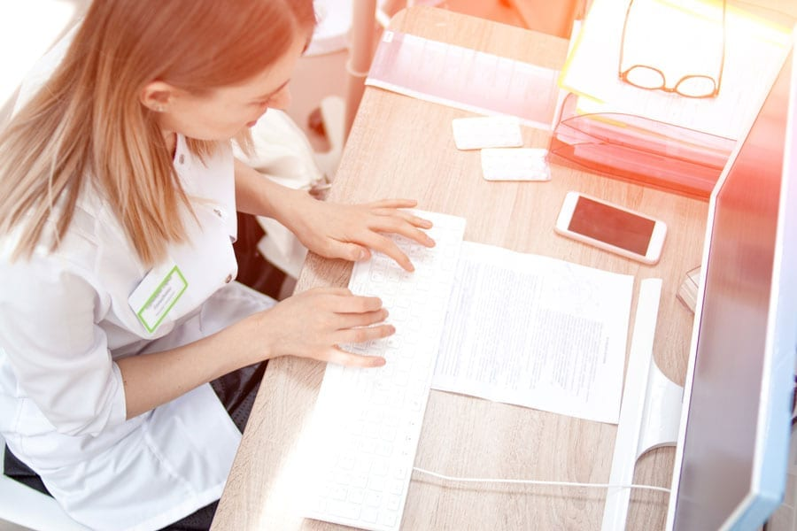 nurse at desk staying productive at work in the morning