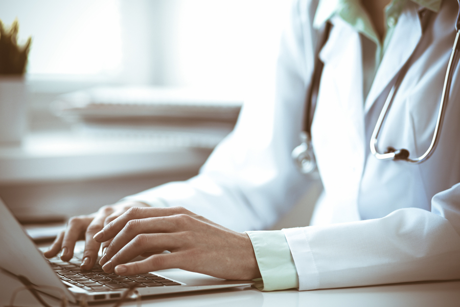 nurse on computer following video interview tips